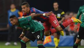 Georgievski (R) battles with Kevin-Prince Boateng; photo: vancouversun.com