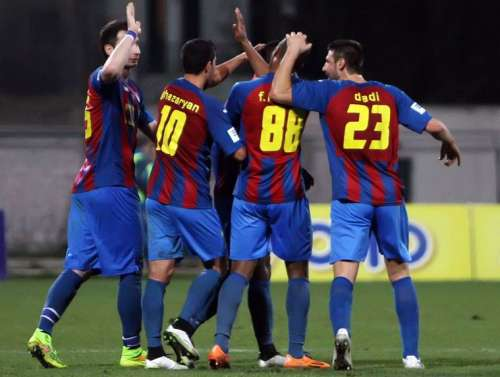 Dimitrovski (#23) celebrates with teammates